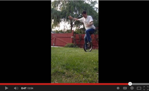 Todd riding a unicycle