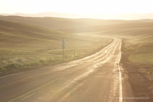 open road at sunrise