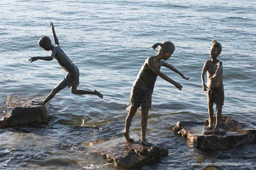 sculpture of kids playing