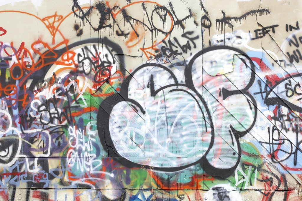 This photo shows a wall of graffiti. To be peaceful I have to apply a double standard for myself. I should not make graffiti, but I should not expect others not to. Anything else is stressful.