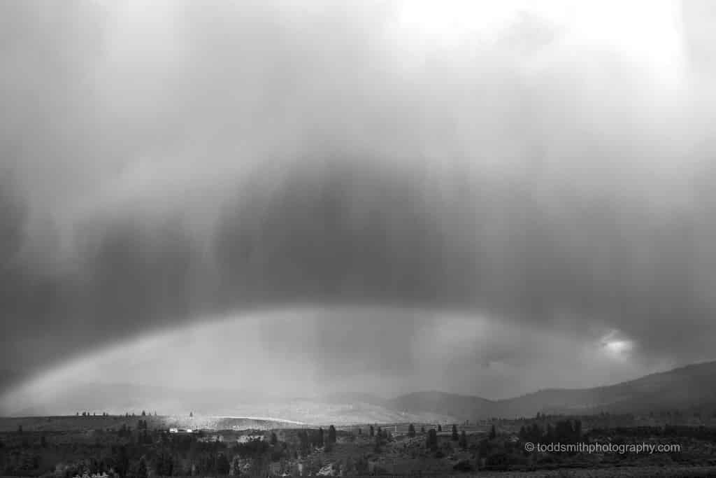 clouds and rainbow in black and white