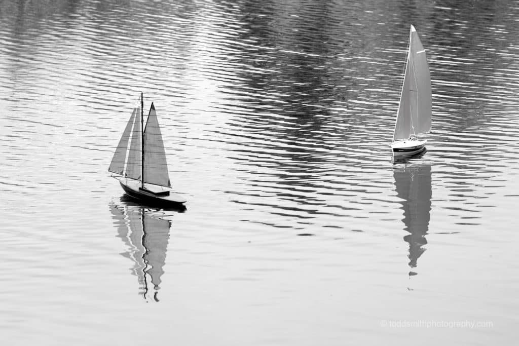 two sailboats on the water